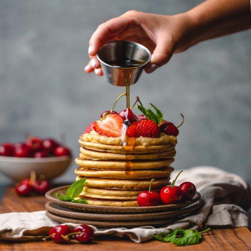 pancakes w-strawberries, syrup, cherries